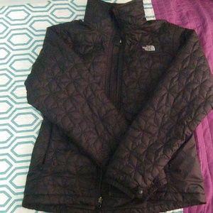 Black zip up north face jacket